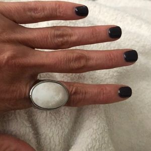 Silver and white/cream ring